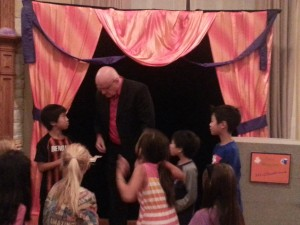 kids having fun at a birthday party magic show