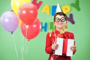 happy lad in funny glasses on birthday party Dallas magician mrgoodfriend